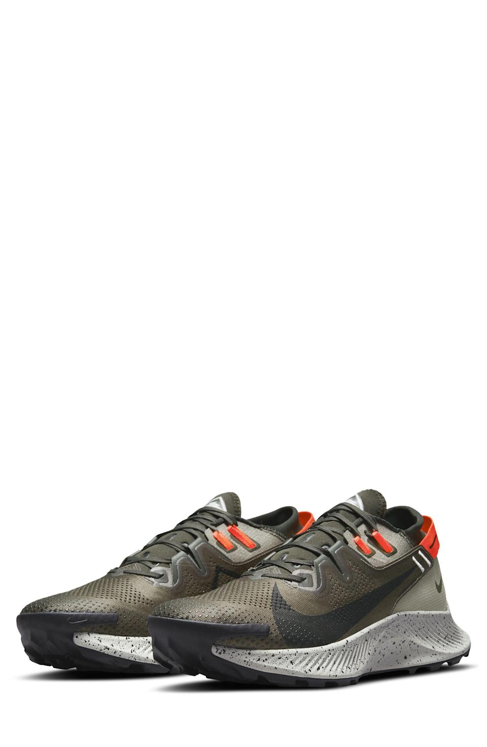"""<p><strong>Nike</strong></p><p>nordstrom.com</p><p><strong>$94.90</strong></p><p><a href=""""https://go.redirectingat.com?id=74968X1596630&url=https%3A%2F%2Fwww.nordstrom.com%2Fs%2Fnike-pegasus-trail-2-trail-running-shoe-men%2F5756811&sref=https%3A%2F%2Fwww.menshealth.com%2Fstyle%2Fg37081969%2Fnordstroms-anniversary-sale-best-sneakers%2F"""" rel=""""nofollow noopener"""" target=""""_blank"""" data-ylk=""""slk:BUY IT HERE"""" class=""""link rapid-noclick-resp"""">BUY IT HERE</a></p><p><del>$130</del><strong><br>$95</strong></p><p>In the mood for some trail running while you're away on your <a href=""""https://www.menshealth.com/technology-gear/g36954813/mens-health-outdoor-awards-2021/"""" rel=""""nofollow noopener"""" target=""""_blank"""" data-ylk=""""slk:camping trip"""" class=""""link rapid-noclick-resp"""">camping trip</a>? We thought you might be. Pack these into your duffel and you'll be good to go.</p>"""