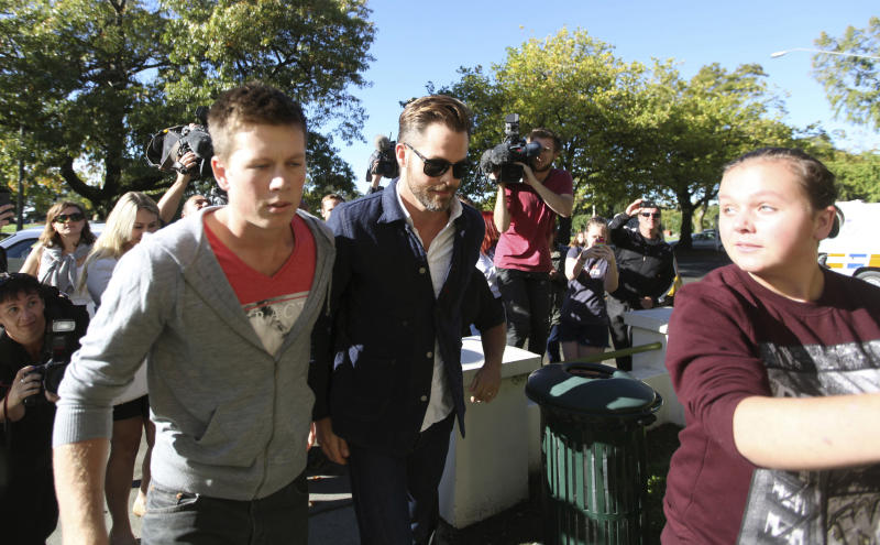 """Hollywood actor Chris Pine, center, arrives at a courthouse in Ashburton, New Zealand, Monday, March 17, 2014. Pine, known for playing Captain Kirk in the """"Star Trek"""" movies, pleaded guilty in the New Zealand court to drunken-driving charges. The 33-year-old was fined $93 New Zealand dollars ($79) and had his New Zealand driver's license suspended for six months during a hearing at the Ashburton District Court. (AP Photo/Ashburton Guardian, Tetsuro Mitomo) NEW ZEALAND OUT, AUSTRALIA OUT, NO SALES"""