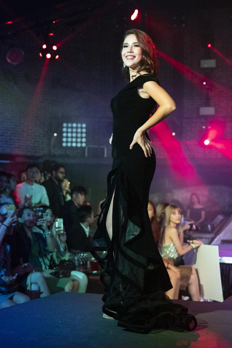 Annika Xue Sager competing in the evening gown segment during the 2019 Miss Universe Singapore at Zouk.