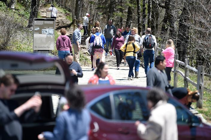 Visitors crowd the Newfound Gap parking lot Sunday in the Great Smoky Mountains National Park.