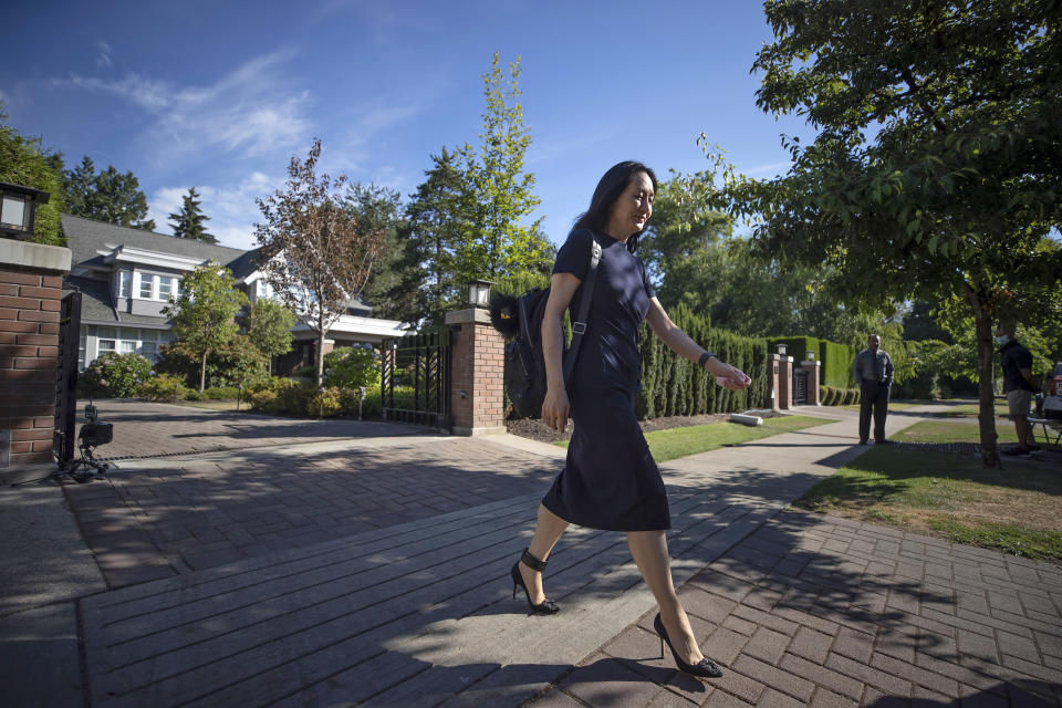Meng Wanzhou, chief financial officer of Huawei, leaves home to attend her extradition hearing at B.C. Supreme Court, in Vancouver, British Columbia, Thursday, Aug. 5, 2021. (Darryl Dyck/The Canadian Press via AP)