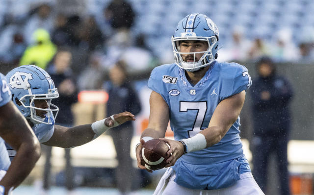 North Carolina's Sam Howell hands off the ball during the first half of an NCAA college football game against Mercer in Chapel Hill, N.C., Saturday, Nov. 23, 2019. (AP Photo/Ben McKeown)