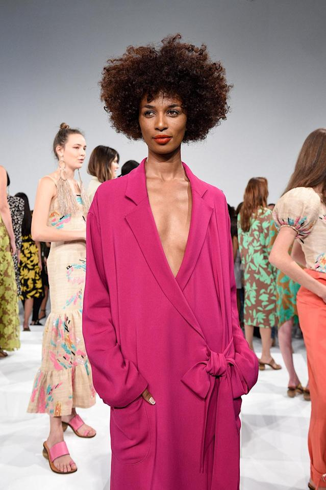 <p>At the Tracy Reese presentation, every model's face was adorned with a pop of color. Some with rosy blush on the apples of their cheeks, others with pops of blue on their lids, and a select few with a gorgeous red-orange matte lip. (Photo: Getty Images) </p>