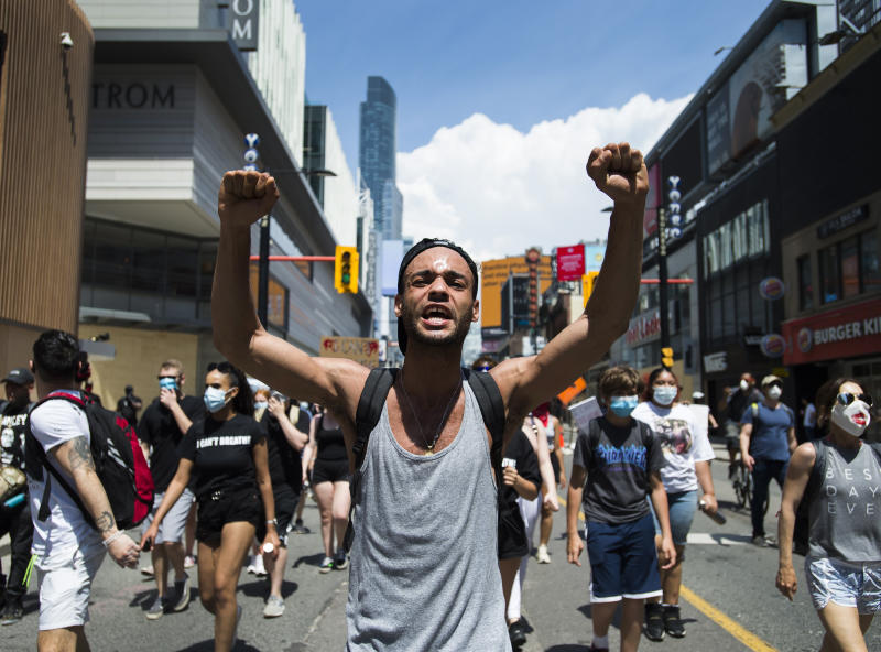 Thousands of people protest at an anti-racism demonstration in Toronto on Friday, June 5, 2020. George Floyd, a black man, died after he was restrained by Minneapolis police officers on May 25. His death has ignited protests in the U.S. and worldwide over racial injustice and police brutality. (Nathan Denette/The Canadian Press via AP)