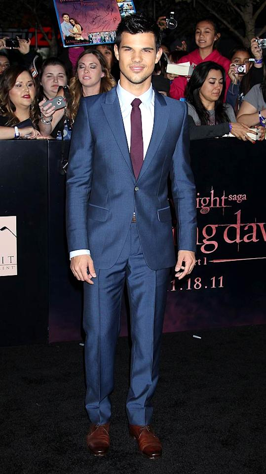 "3. Taylor Lautner -- in a navy Alexander McQueen suit, maroon tie, and brown brogues -- at the Los Angeles premiere of ""Breaking Dawn - Part 1."" (11/14/2011)"