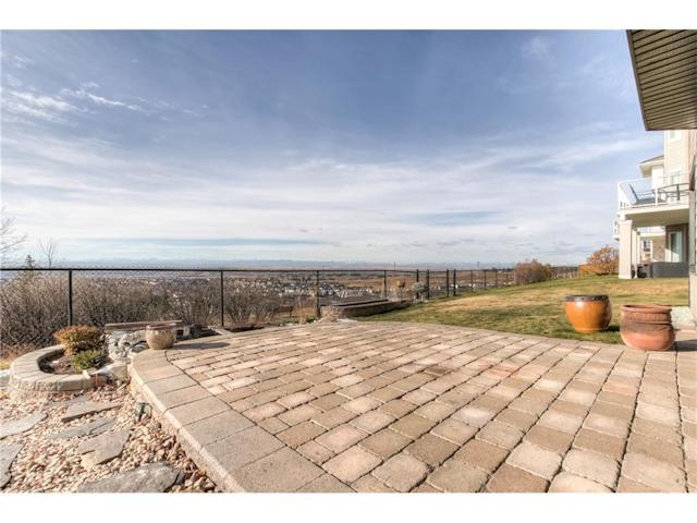 <p><span>299 Rocky Ridge Drive Northwest, Calgary, Alta.</span><br> Take in the unobstructed views from the patio.<br> (Photo: Zoocasa) </p>