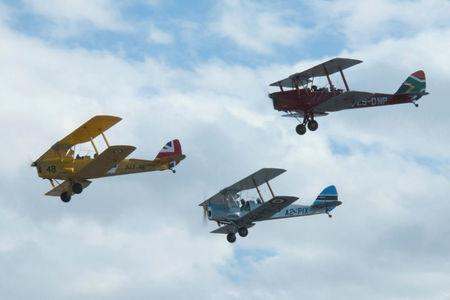 Biplanes representing Britain, Botswana and South Africa fly during the start of the Vintage Air Rally over the airport of Sitia on the island of Crete, Greece