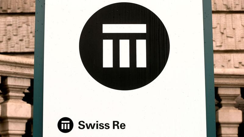 FILE PHOTO: The logo of Swiss insurer Swiss Re is seen in front of its headquarters in Zurich