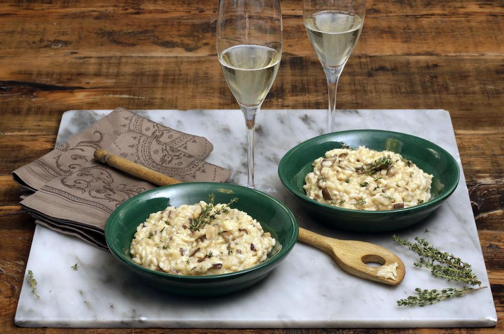 <p>Okay, we're not entirely sure why but risotto is one of those romantic dishes. Whether it's a simple parmesan risotto or something a bit more complicated and indulgent, you're pretty much guaranteed to impress. [Photo: Rex] </p>