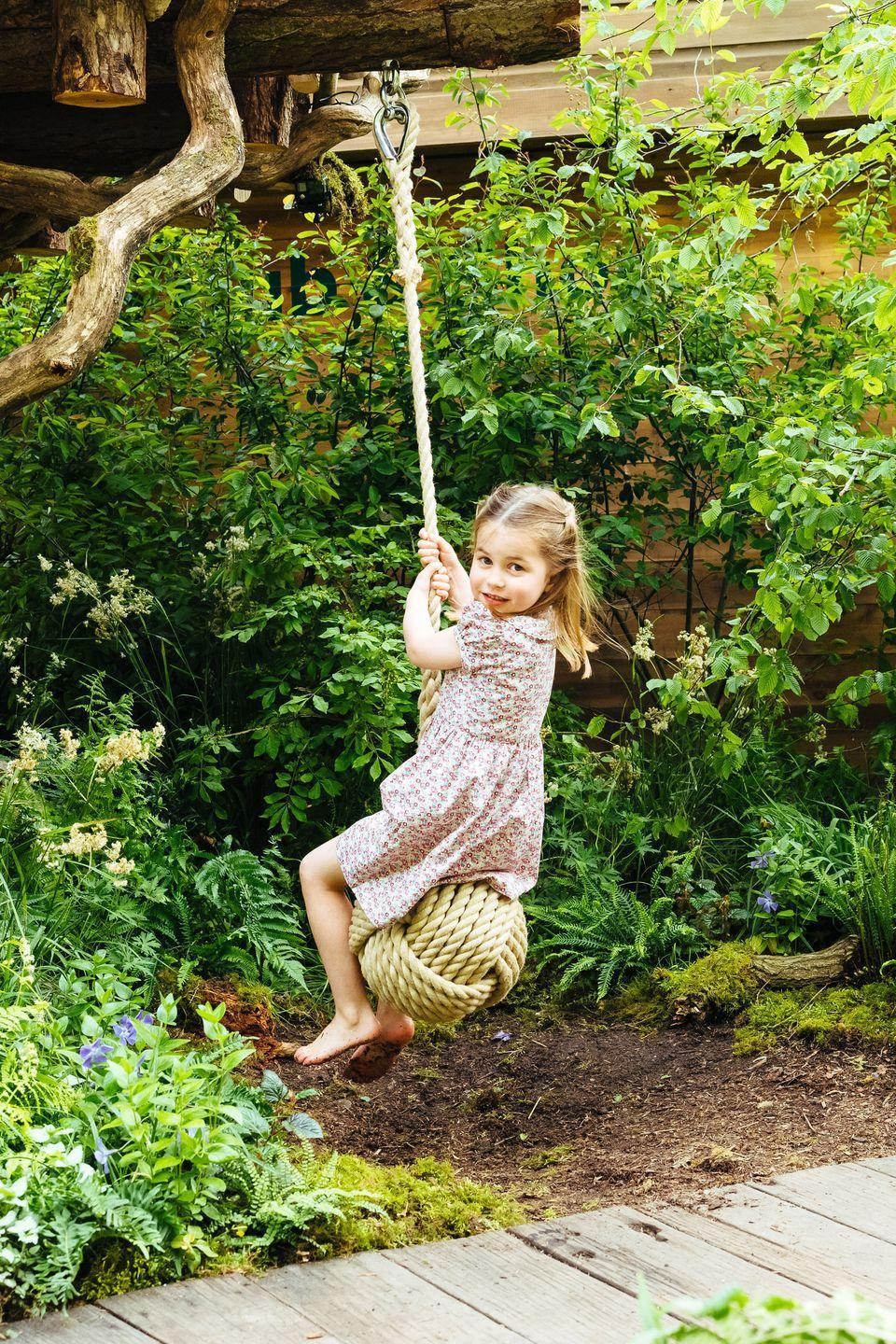 <p>Princess Charlotte is all smiles as she takes a turn on the swing. </p>