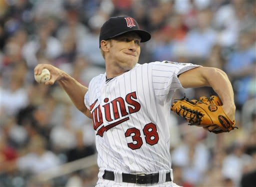 Minnesota Twins pitcher Cole DeVries throws against the Tamp Bay Rays in the first inning of a baseball game on Friday, Aug. 10, 2012, in Minneapolis. (AP Photo/Jim Mone)