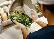 A worker prepares an order in the kitchen at the newest Chopt Creative Salad Co., location in New York