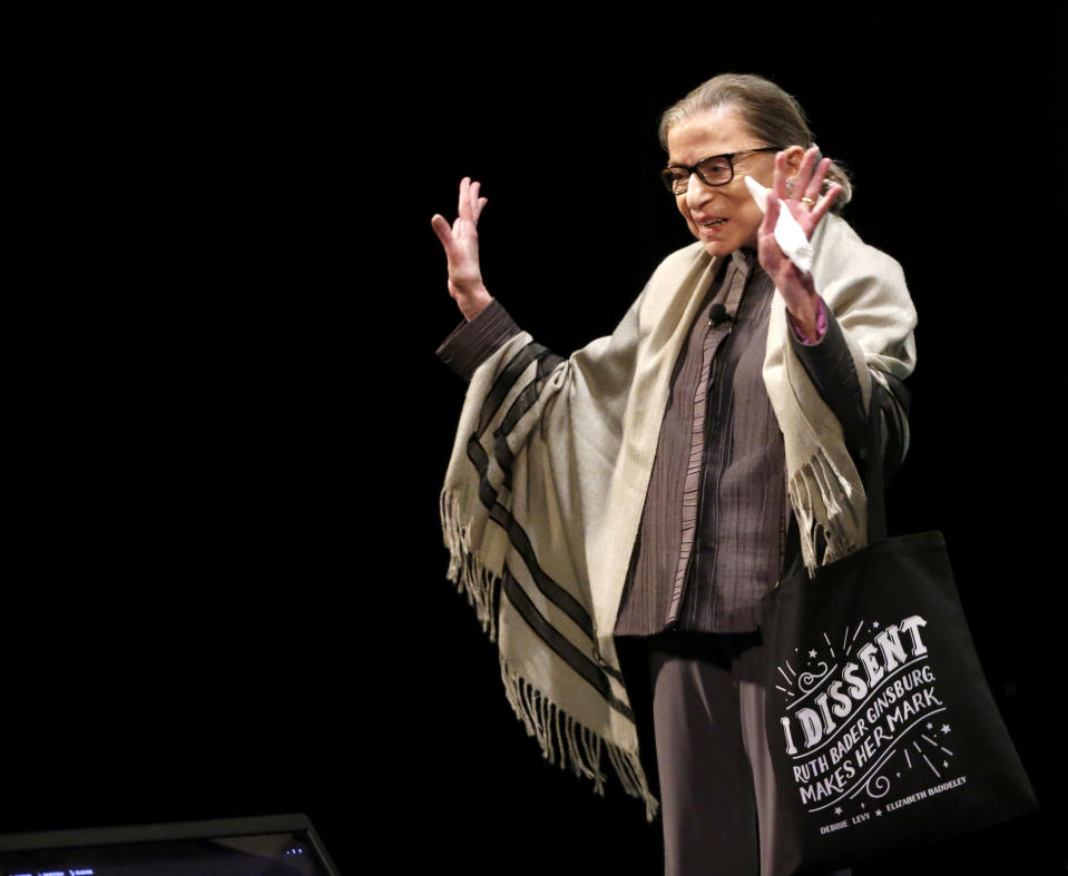 Supreme Court Justice Ruth Bader Ginsburg waves to the crowd before an appearance at Roosevelt University in Chicago in 2017. (AP Photo/Charles Rex Arbogast)