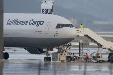 Airport employees load platforms with coffins onto a cargo plane at the Marseille Provence Airport in Marignane, France, June 9, 2015 as Lufthansa prepares to transport coffins with the remains of 44 victims of the Germanwings Airbus A320 crash from Marseille, France, to Duesseldorf, Germany. REUTERS/Jean-Paul Pelissier