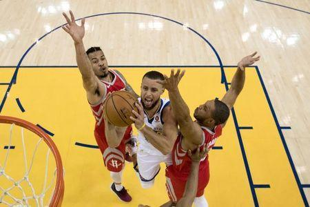 May 20, 2018; Oakland, CA, USA; Golden State Warriors guard Stephen Curry (30) shoots the basketball against Houston Rockets guard Gerald Green (14) and guard Eric Gordon (10) during the first half in game three of the Western conference finals of the 2018 NBA Playoffs at Oracle Arena. The Warriors defeated the Rockets 126-85. Mandatory Credit: Kyle Terada-USA TODAY Sports