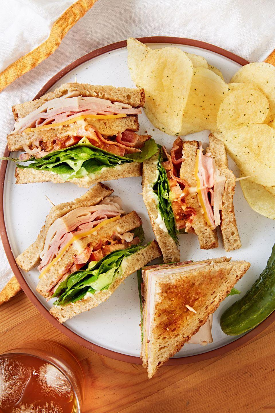 """<p>With ham, turkey, bacon and 3 slices of bread, the club sandwich is the best sandwich of all time. </p><p>Get the recipe from <a href=""""https://www.delish.com/cooking/recipe-ideas/a32714107/club-sandwich-recipe/"""" rel=""""nofollow noopener"""" target=""""_blank"""" data-ylk=""""slk:Delish"""" class=""""link rapid-noclick-resp"""">Delish</a>.</p>"""