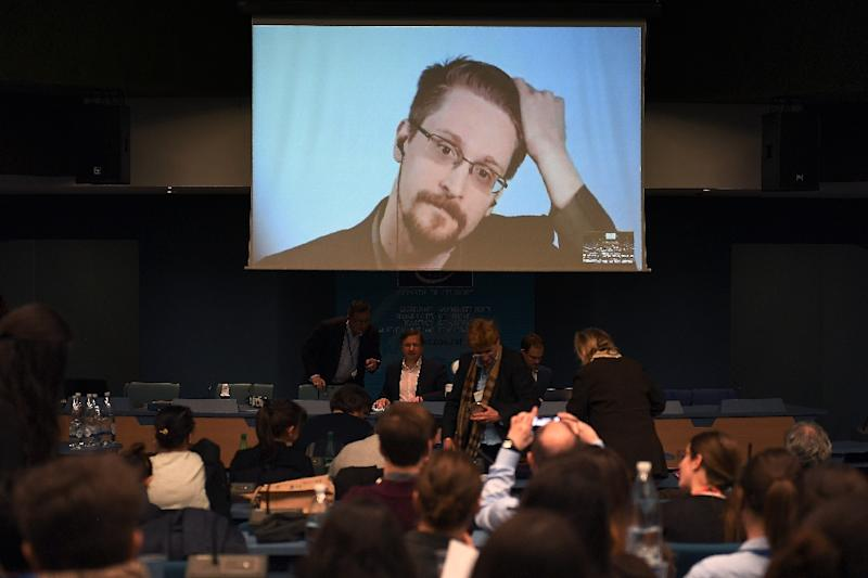 Former US National Security Agency (NSA) contractor Edward Snowden speaks via video link from Russia