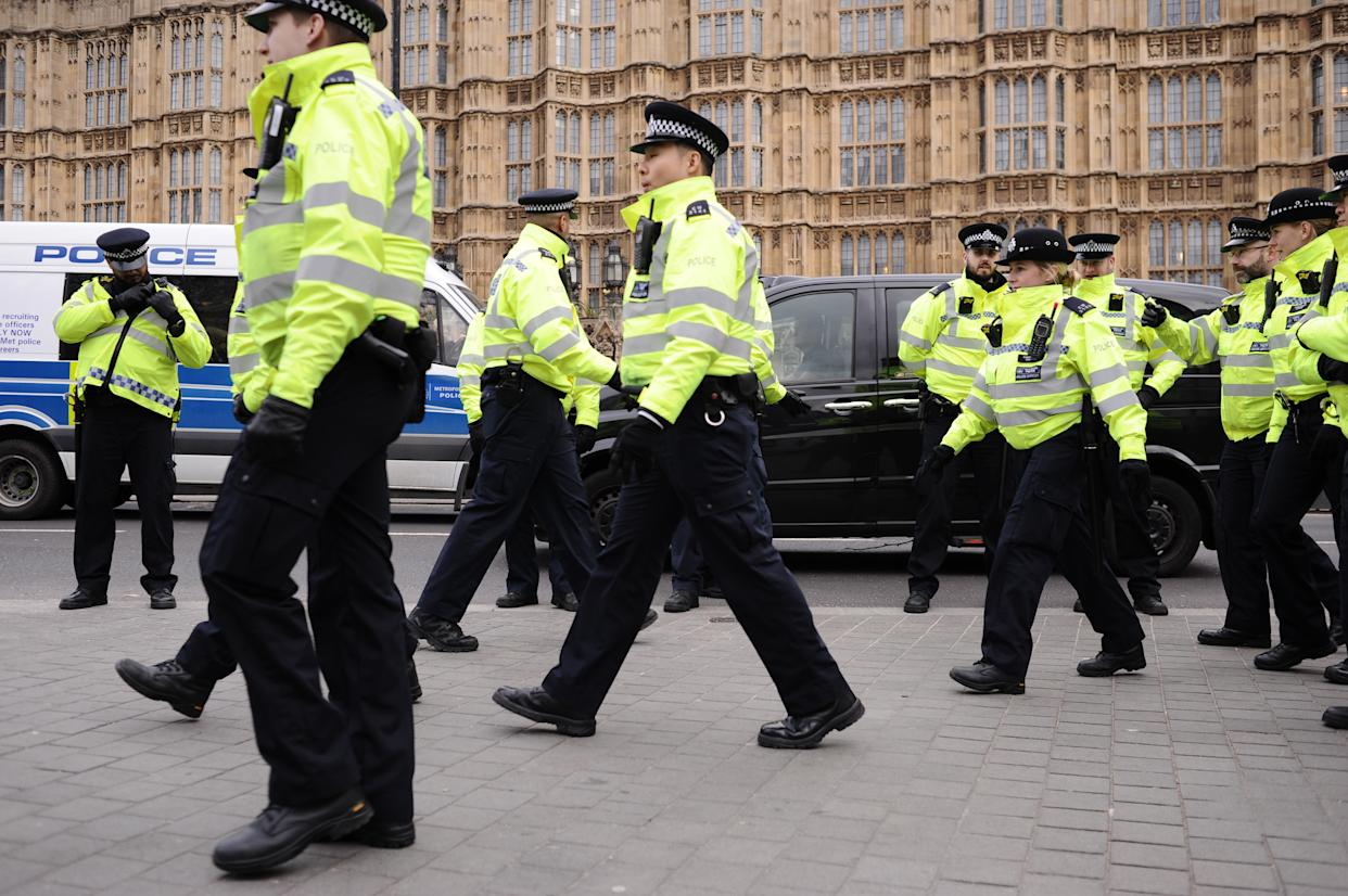Police officers approach Brexit supporters and opponents demonstrating opposite the Houses of Parliament in London, England, on January 29, 2019. In the Commons, on a day of significant parliamentary activity over Brexit, MPs voted down a cross-party amendment tabled by Labour Party MP Yvette Cooper and Conservative Party MP Nick Boles designed to substantially reduce the risk of a much-feared 'no-deal' exit from the EU. An amendment rejecting the principle of a no-deal exit was meanwhile approved, as was a government-backed amendment championed by Conservative Party MP Graham Brady calling for 'alternative arrangements' to take the place of the controversial Irish 'backstop' provision in the withdrawal agreement negotiated with the EU. (Photo by David Cliff/NurPhoto via Getty Images)