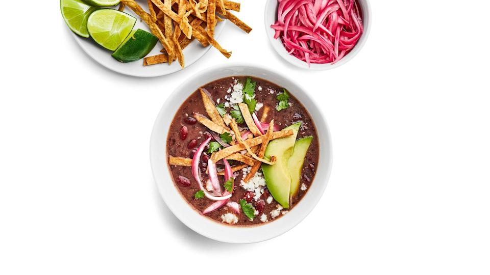 """Got an Instant Pot? Add this to your weeknight rotation. While the beans cook, you can prepare an array of fun toppings. <a href=""""https://www.epicurious.com/recipes/food/views/instant-pot-red-bean-and-quinoa-soup-with-taco-fixins?mbid=synd_yahoo_rss"""" rel=""""nofollow noopener"""" target=""""_blank"""" data-ylk=""""slk:See recipe."""" class=""""link rapid-noclick-resp"""">See recipe.</a>"""