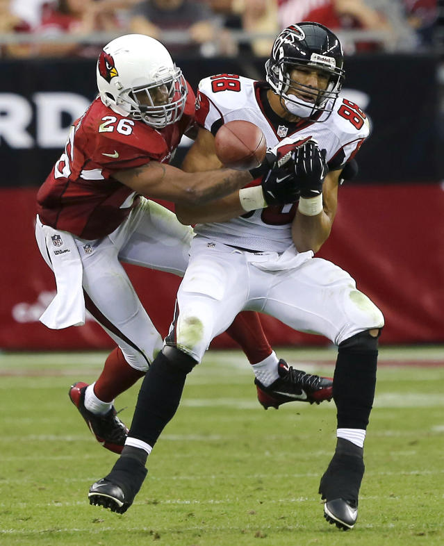 Arizona Cardinals free safety Rashad Johnson (26) breaks up a pass intended for Atlanta Falcons tight end Tony Gonzalez during the second half of an NFL football game Sunday, Oct. 27, 2013, in Glendale, Ariz. The Cardinals won 27-13. (AP Photo/Rick Scuteri)