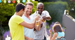 Men enjoying beer while grilling food copyright Monkey Business Images/Shutterstock.com