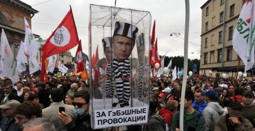Opposition activists carry a carry a model of a prison cell with the cut-out figure of President Vladimir Putin during a rally in Saint-Petersburg last month. In just over two months since Vladimir Putin returned to the Kremlin, Russia's parliament has rushed through a flurry of legislation giving him new powers to crack down on the opposition movement