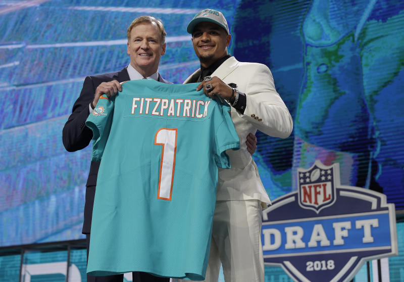 Commissioner Roger Goodell, left, poses with Alabama's Minkah Fitzpatrick after Fitzpatrick was selected by the Miami Dolphins during the first round of the NFL football draft, Thursday, April 26, 2018, in Arlington, Texas. (AP Photo/David J. Phillip)