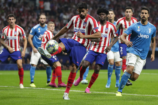 Atletico Madrid's Angel Correa kicks the ball during the Champions League Group D soccer match between Atletico Madrid and Juventus at Wanda Metropolitano stadium in Madrid, Spain, Wednesday, Sept. 18, 2019. (AP Photo/Manu Fernandez)