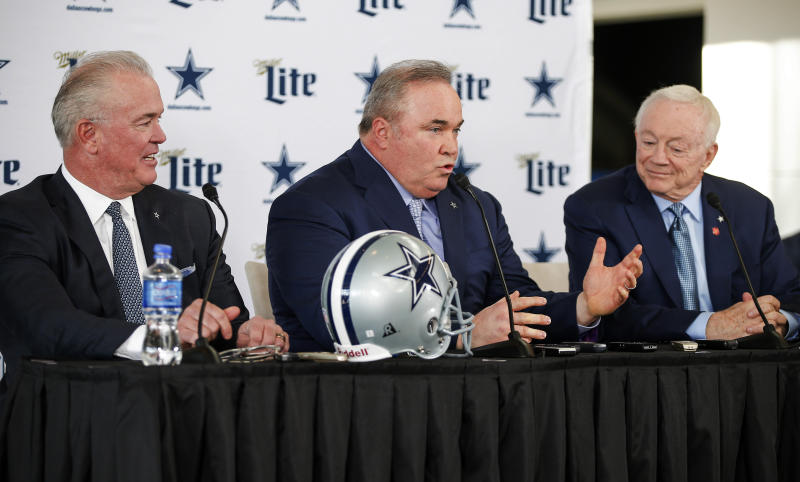 New Dallas Cowboys head coach Mike McCarthy, center, is introduced by Chief Operating Officer Stephen Jones, left, and owner Jerry Jones, right, during a press conference at the Dallas Cowboys headquarters Wednesday, Jan. 8, 2020, in Frisco, Texas. (AP Photo/Brandon Wade)
