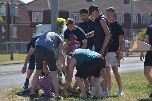 Friends and family of the dead youths lay flowers at the site of the crash. (SWNS)