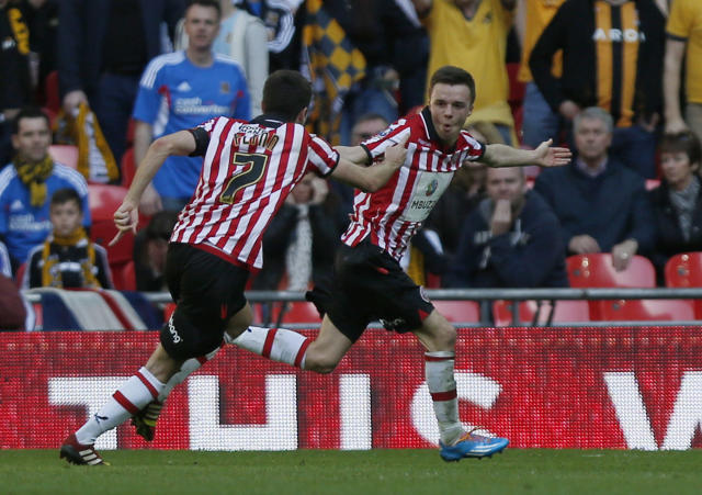 Sheffield United's Stefan Scougall, right, celebrates his goal against Hull City with teammate Ryan Flynn during their English FA Cup semifinal soccer match at Wembley Stadium in London, Sunday, April 13, 2014. (AP Photo/Sang Tan)