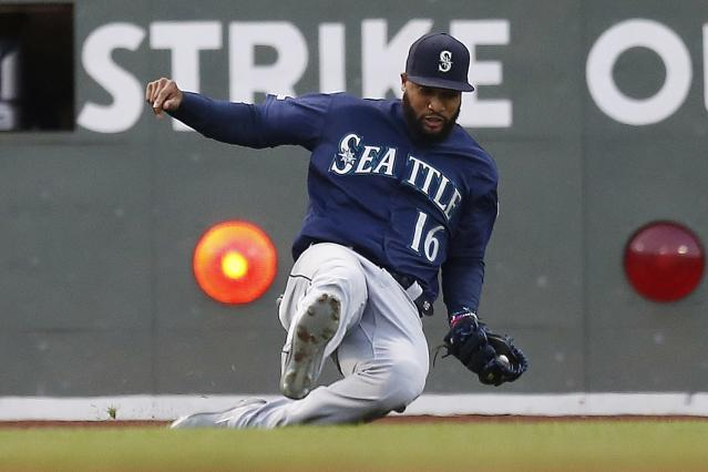 Seattle Mariners' Domingo Santana makes the catch for the out on a fly ball by Boston Red Sox's Andrew Benintendi during the first inning of a baseball game in Boston, Friday, May 10, 2019. (AP Photo/Michael Dwyer)