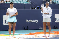 Bianca Andreescu of Canada, left, and Ashleigh Barty of Australia, right pose with their trophies after the finals at the Miami Open tennis tournament, Saturday, April 3, 2021, in Miami Gardens, Fla. Barty won 6-3, 4-0, as Andreescu retired due to injury. (AP Photo/Lynne Sladky)