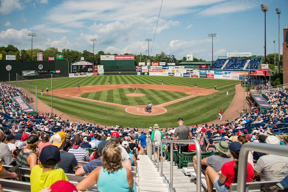 "<p><strong>Big picture: What's the vibe of the place, what's it like?</strong> Renovated in 1993, this 7,368-seat minor league baseball stadium is known for its terrific sight lines, friendly fans, and the classic vibe by way of the brick facade.</p> <p><strong>What kinds of events can we see here?</strong> This is home to The Portland Sea Dogs, the city's minor league baseball team—an incubator for the <a href=""https://www.cntraveler.com/activities/boston/fenway-park?mbid=synd_yahoo_rss"" rel=""nofollow noopener"" target=""_blank"" data-ylk=""slk:Boston Red Sox"" class=""link rapid-noclick-resp"">Boston Red Sox</a>.</p> <p><strong>How are the seats?</strong> The sightlines are one of the standout elements of a game at Hadlock Field. Seating is comfortably spaced and meticulously maintained, and the stadium's dimensions get you a bird's eye view of all the action.</p> <p><strong>Good for kids?</strong> My kids tagged along, and had a blast. Hadlock's intimate size and layout meant we could get close to the game and feel involved in its energy. The kids also loved being so close to the players, and unlike in some bigger venues, weren't overwhelmed by the crush of the crowd.</p> <p><strong>Anything in particular that makes this place special?</strong> Like any good stadium, it's got its own campy ritual: Whenever a Sea Dogs player hits a home run or the team wins the game, a lighthouse rises from the centerfield fence.</p> <p><strong>What—and who—do you think this is best for?</strong> Baseball fans, particular Red Sox fans since the Sea Dogs became a Sox affiliate in 2003, who relish really seeing the sport—and up-and-coming players—will adore this place. </p>"