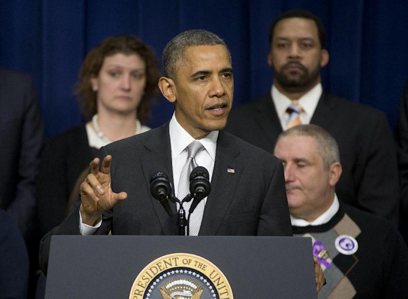 President Barack Obama speaks about the new health care law, Tuesday, Dec. 3, 2013, in the South Court Auditorium in the Eisenhower Executive Office Building on the White House complex in Washington. The President argued that his health law is preventing insurance discrimination against those with pre-existing conditions and is allowing young people to stay on their parents' coverage until age 26. On stage with the president are Americans the White House says have gained as a result of the Affordable Care Act. (AP Photo/Carolyn Kaster)