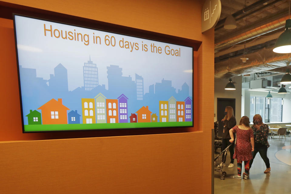 A video display shows one of the goals of Mary's Place, a family homeless shelter located inside an Amazon corporate building on the tech giant's Seattle campus, Wednesday, June 17, 2020. The facility is home to the Popsicle Place shelter program, an initiative to address the needs of homeless children with life-threatening health conditions. (AP Photo/Ted S. Warren)