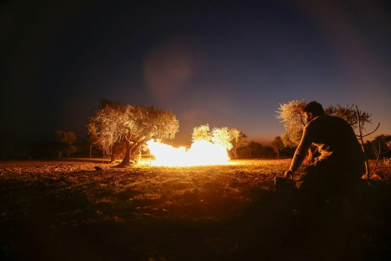 A Syrian rebel fires a rocket towards regime forces positions in the southern countryside of Aleppo (AFP Photo/Omar HAJ KADOUR)