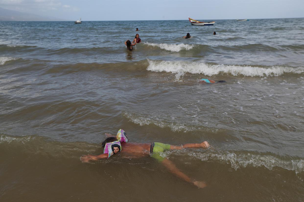 Children play along the shore of the La Salina area, from where Maroly Bastardo disappeared, in Guiria, Venezuela, on May 24. (Photo: Ivan Alvarado/Reuters)
