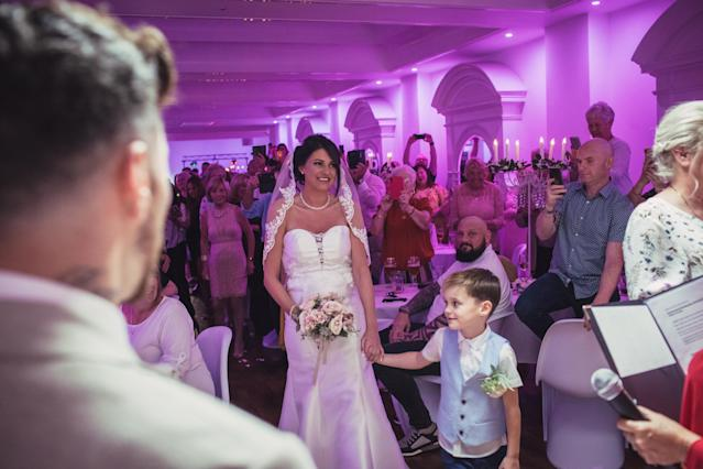 The couple surprised their guests by tying the knot at their engagement party (SWNS)