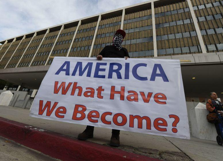 Immigrant rights groups protest on January 29, 2018, outside the Federal Building in Los Angeles, against the arrest of a Tucson-based 'No More Deaths' group activist. The activist was arrested by border patrol in a remote area of Arizona afterleaving water for immigrants crossing from Mexico. / AFP PHOTO / Mark RALSTONMARK RALSTON/AFP/Getty Images ** OUTS - ELSENT, FPG, CM - OUTS * NM, PH, VA if sourced by CT, LA or MoD **