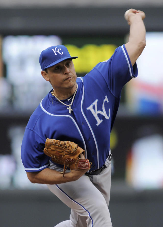 Kansas City Royals pitcher Jason Vargas throws against the Minnesota Twins during the first inning of a baseball game in Minneapolis, Sunday, April 13, 2014. (AP Photo/Tom Olmscheid)