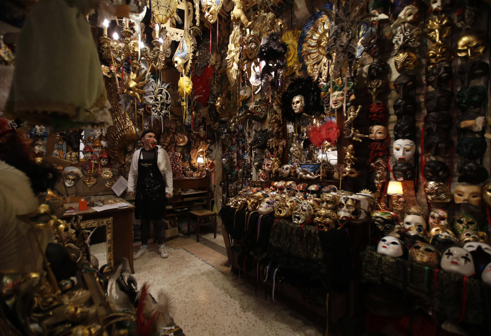 Carnival masks placed on display in a Venetian artisan mask makers workshop in Venice, Italy, Saturday, Jan. 30, 2021. Last year, with fear over the new coronavirus mounting, authorities abruptly shut down Venice Carnival on its third day, just before Italy became the first country in the West facing a outbreak. (AP Photo/Antonio Calanni)