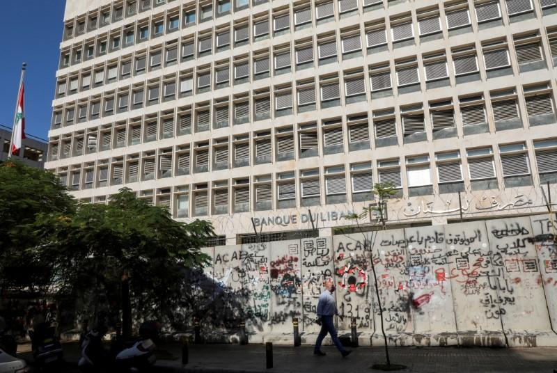 FILE PHOTO: A man walks past the Central Bank building, in Beirut