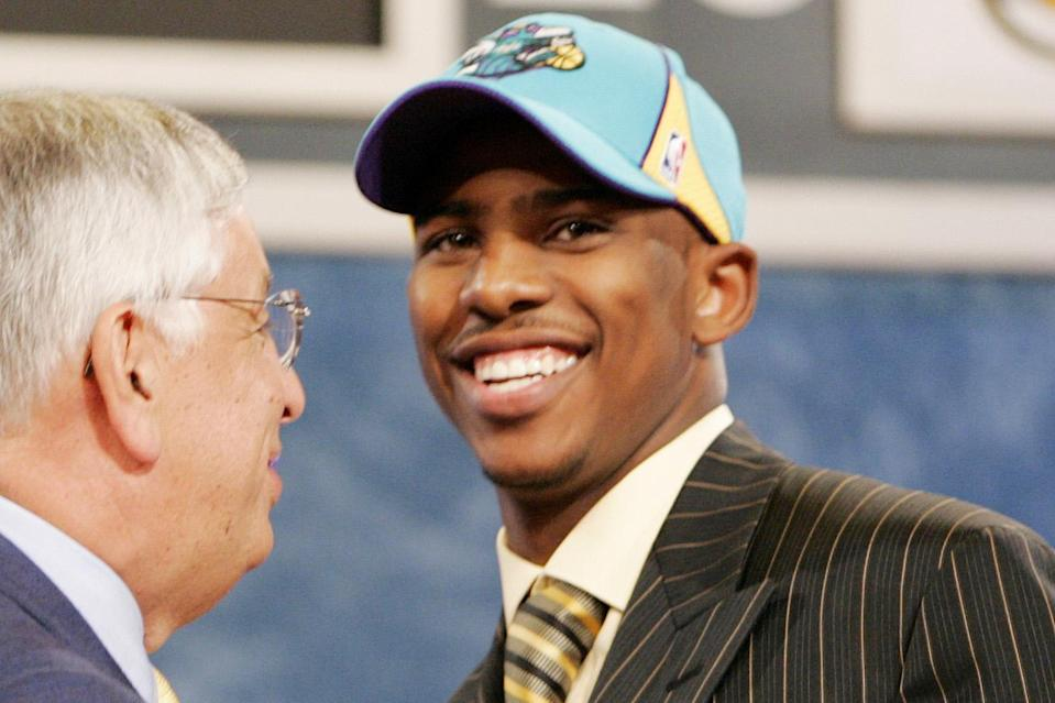 Former commissioner David Stern welcomes Chris Paul to the New Orleans Hornets in the 2005 NBA draft. (AP)