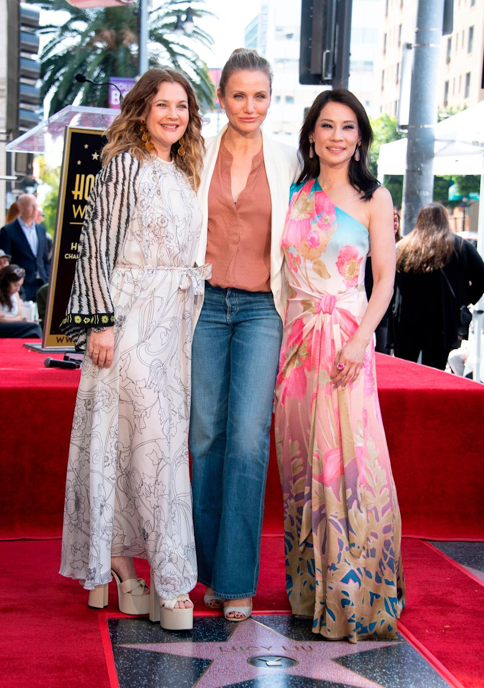 Drew Barrymore, Cameron Diaz and Lucy Liu stand on the star during Liu's Walk of Fame ceremony in Hollywood. (Photo: VALERIE MACON via Getty Images)