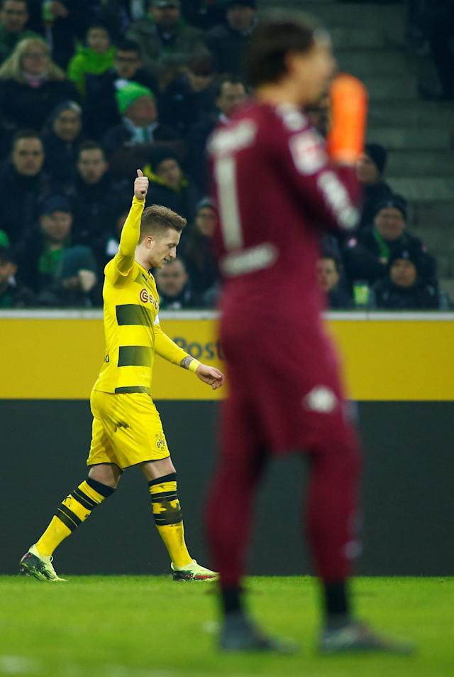 Soccer Football - Bundesliga - Borussia Moenchengladbach vs Borussia Dortmund - Borussia-Park, Moenchengladbach, Germany - February 18, 2018 Borussia Dortmund's Marco Reus celebrates scoring their first goal REUTERS/Thilo Schmuelgen DFL RULES TO LIMIT THE ONLINE USAGE DURING MATCH TIME TO 15 PICTURES PER GAME. IMAGE SEQUENCES TO SIMULATE VIDEO IS NOT ALLOWED AT ANY TIME. FOR FURTHER QUERIES PLEASE CONTACT DFL DIRECTLY AT + 49 69 650050