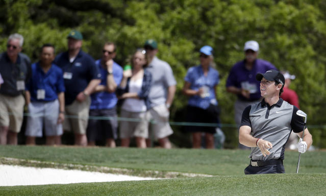 Rory McIlroy, of Northern Ireland, watches his shot out of a bunker on the first hole during the second round of the Masters golf tournament Friday, April 11, 2014, in Augusta, Ga. (AP Photo/Darron Cummings)