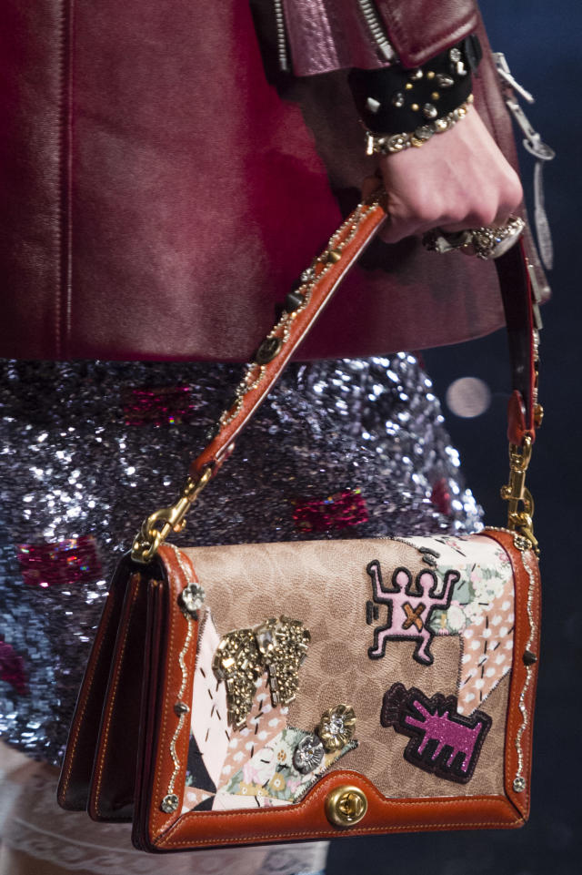 <p><i>Brown leather flap purse with Keith Haring patches from the SS18 Coach collection. (Photo: ImaxTree) </i></p>