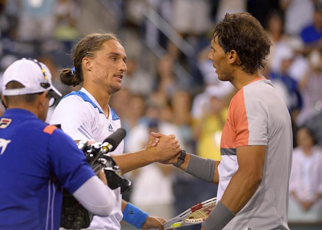 Alexandr Dolgopolov, left, of Ukraine, shakes hands with Rafael Nadal, of Spain, after defeating him in their match at the BNP Paribas Open tennis tournament, Monday, March 10, 2014, in Indian Wells, Calif. Dolgopolov won 6-3, 3-6, 7-6 (5). (AP Photo/Mark J. Terrill)