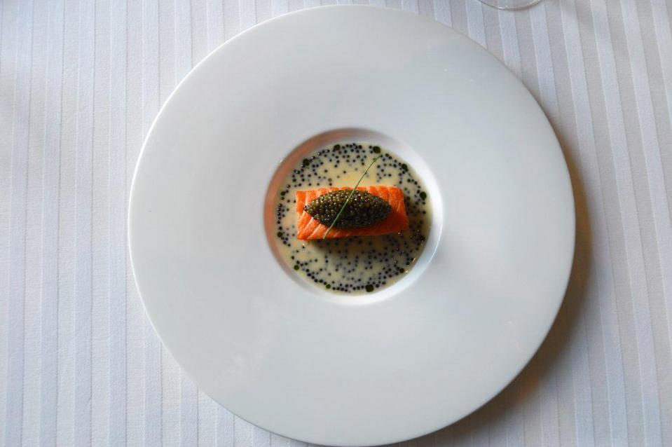 "<p>Delicate salmon prepared ""mi cuit"" (sous vide in a salt bath that creates a decadent texture) is a luxury rarely seen in restaurants, except at <a href=""https://www.tripadvisor.com/Restaurant_Review-g45963-d650768-Reviews-Restaurant_Guy_Savoy-Las_Vegas_Nevada.html"" rel=""nofollow noopener"" target=""_blank"" data-ylk=""slk:Guy Savoy"" class=""link rapid-noclick-resp"">Guy Savoy</a>. The French institution serves the fish atop a luscious beurre blanc, and is garnished with a dollop of Ossetra caviar, aka one of the world's finest caviars.</p>"